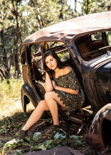 girl sitting in antique car