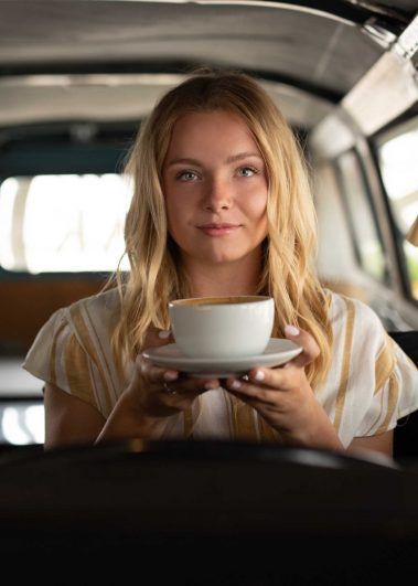 girl holding teacup