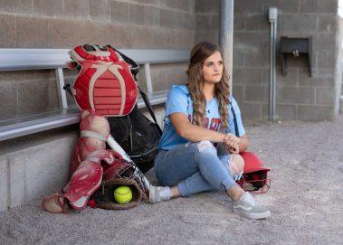 girl with softball gear
