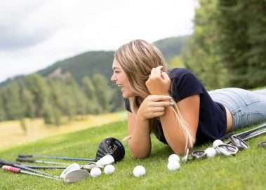 girl laying on golf course