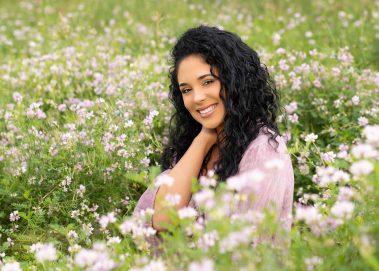 smiling senior in field of flowers