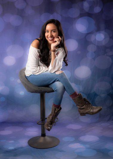 senior girl sitting on chair