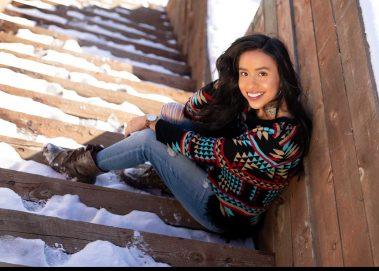girl sitting on snowy steps