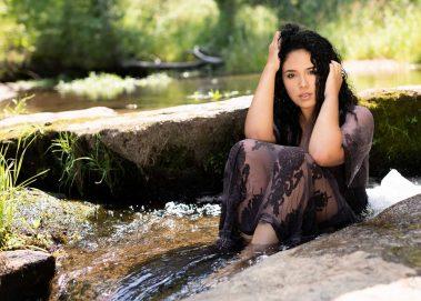 senior girl sitting in stream