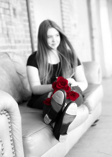 black and white with red roses