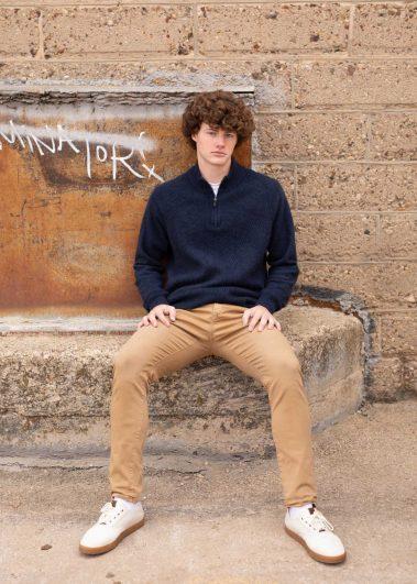 senior sitting on concrete
