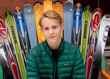 boy next to snow skis