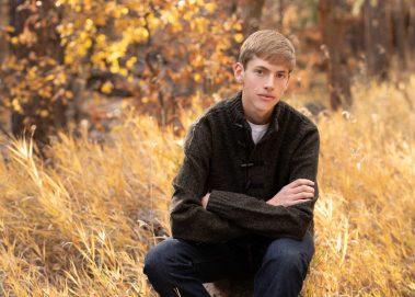 senior sitting in forest