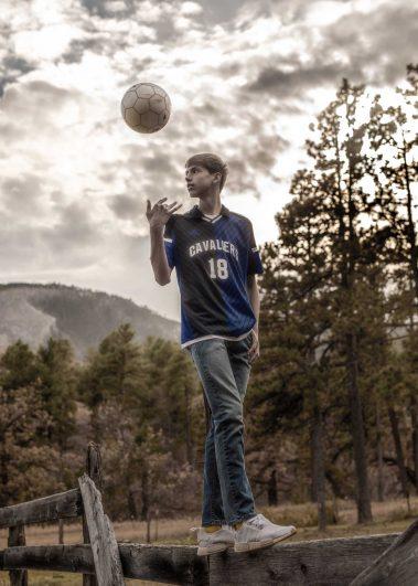 senior boy throwing ball