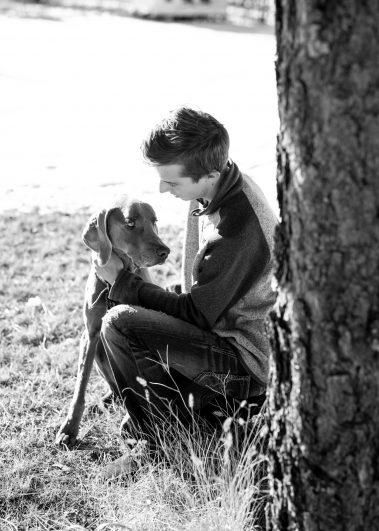 boy kneeling with dog
