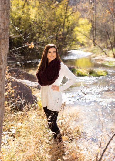 girl next to creek