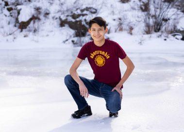 boy kneeling on ice