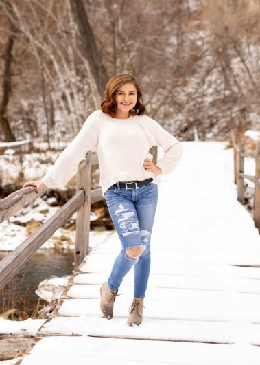 girl on snow covered bridge