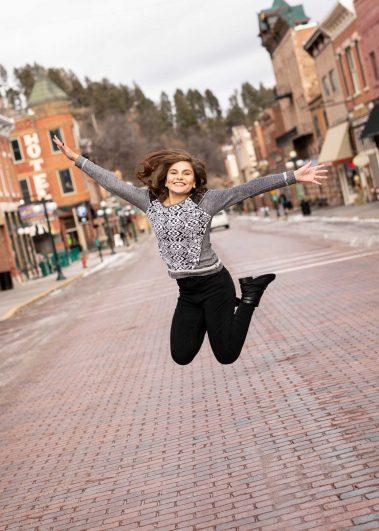 senior girl jumping