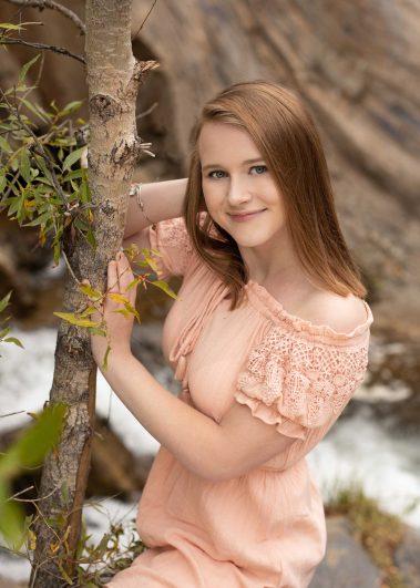 girl next to tree