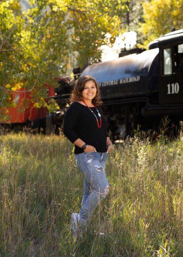 senior girl near train