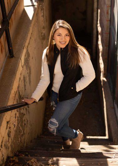 senior girl on stairs