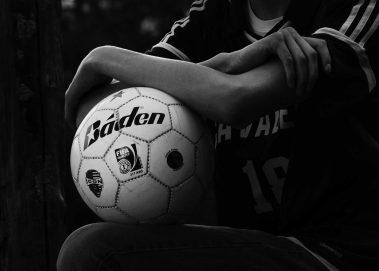 senior holding soccer ball