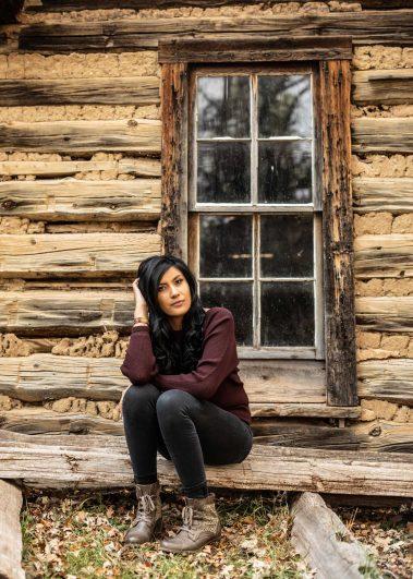 senior girl sitting on log