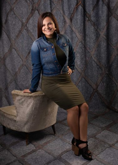 senior girl leaning on chair