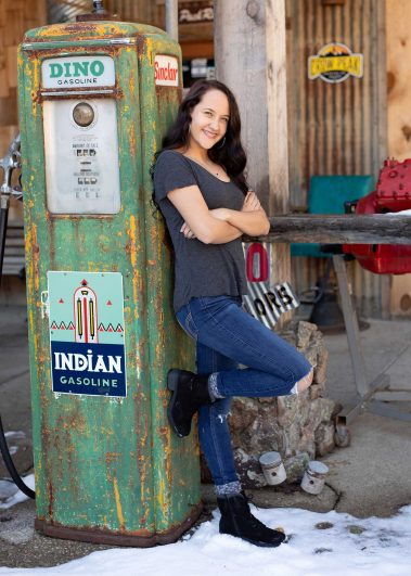 senior girl next to gas pump