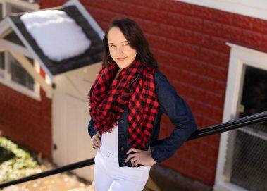 senior girl on stairs smiling