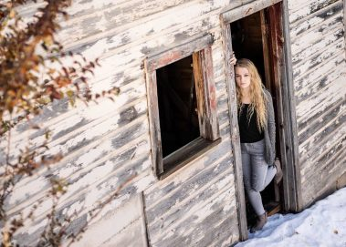 senior girl in rustic cabin