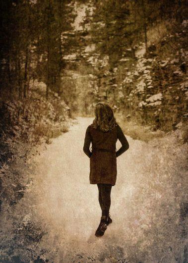 senior walking down path