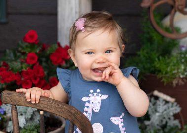 baby showing 2 teeth