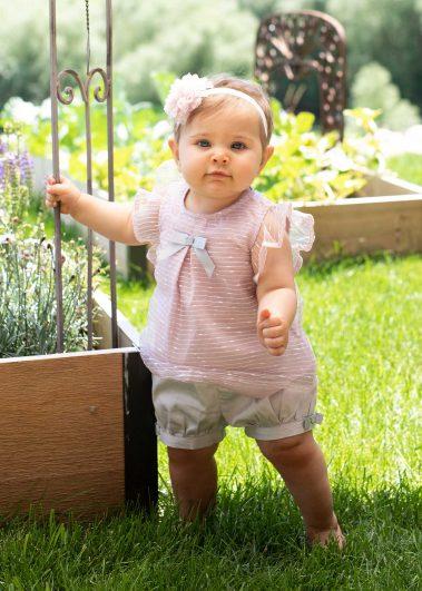 baby standing in garden