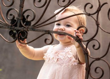 baby smiling through iron art