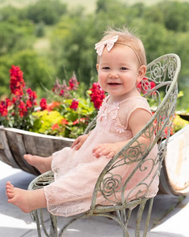smiling baby on iron chair