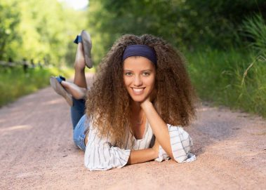 girl laying on path