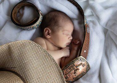 newborn with western belt