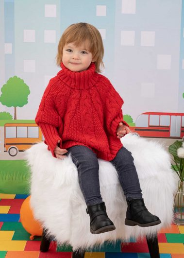 little girl in red sweater