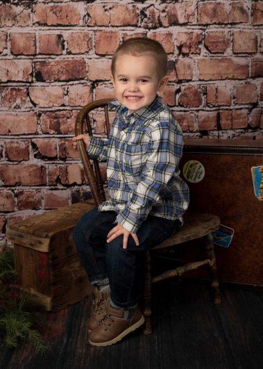 little boy in chair