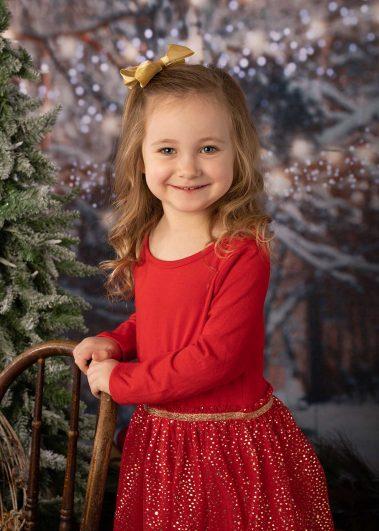 little girl in red Christmas dress