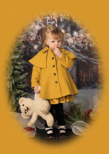 little girl in yellow coat