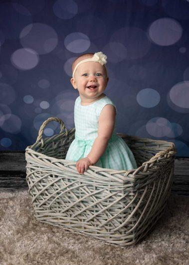 baby girl in wicker basket