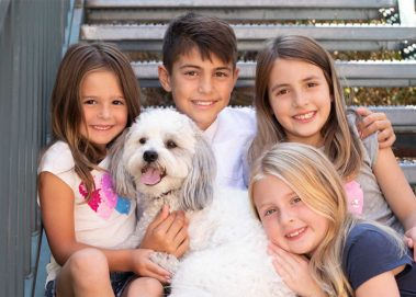siblings with family dog