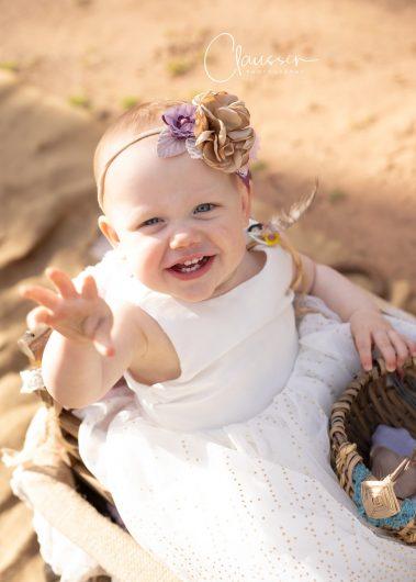 baby waving at camera