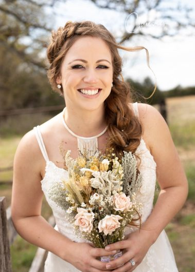bride outdoors smiling