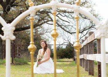 bride sitting in field