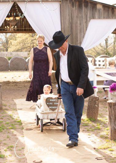 wagon pulling baby down aisle