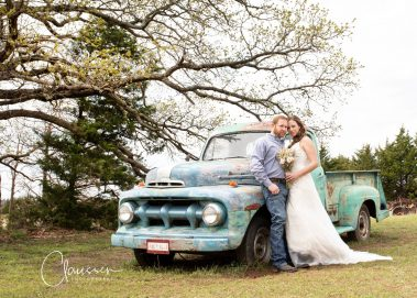bride and groom with antique truck