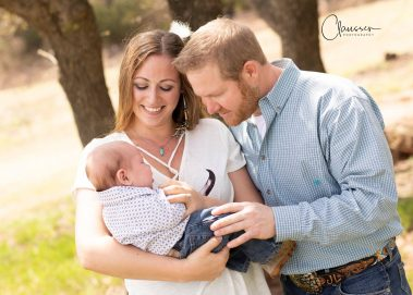 couple smiling at baby