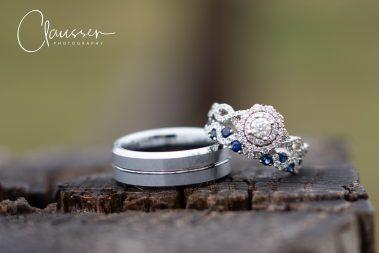 wedding rings on log