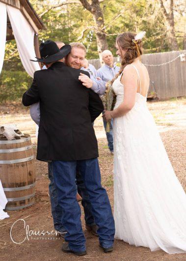 congratulating bride and groom