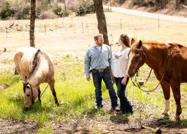 couple outdoors with horses