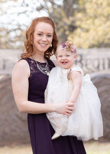 mom and baby smiling at camera